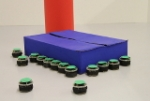 Occlusion-Based Cooperative Transport with a Swarm of Miniature Mobile Robots