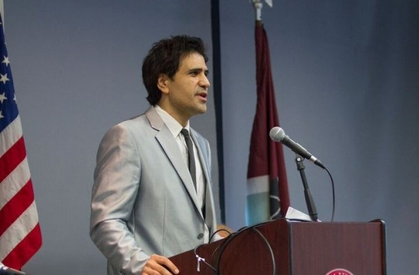 Dr. Majid Rafizadeh is giving a speech at a global and world leaders' event.