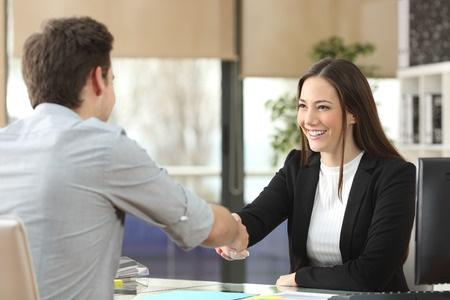 Woman Shakes Hand at Negotiation Meeting