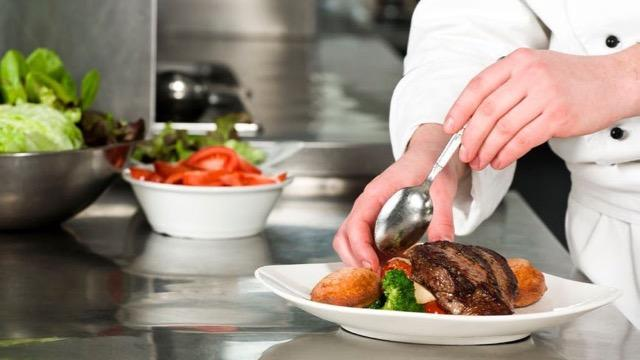 Chef Prepares Fresh Meal at Restaurant