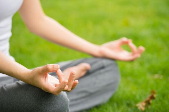 Wellness and Meditation on Green Grass