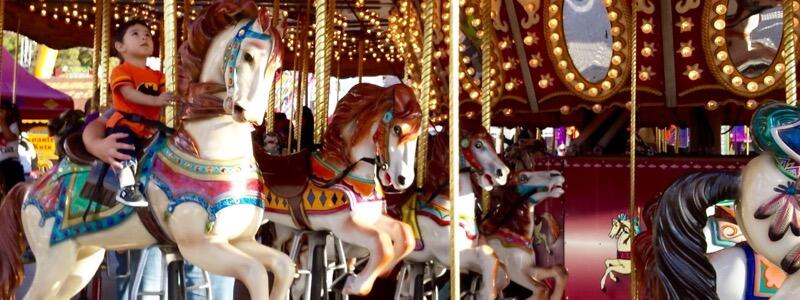 Riding the Carousel at the Carnival (Photo by Niki Lanter)