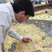 David Weimer pointing at a map